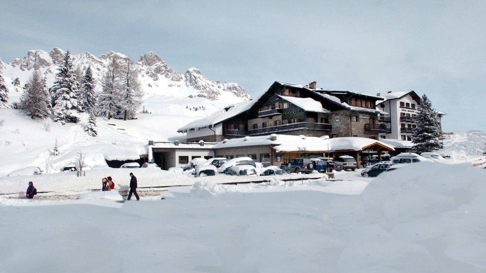 Hotel Monzoni surrounded by snow during the winter season