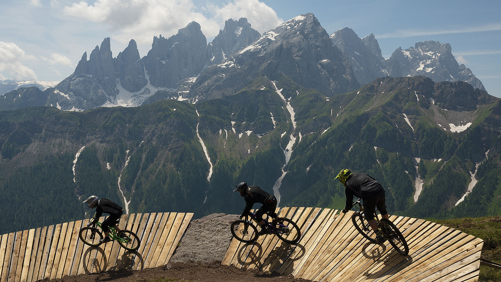 A family loads their bikes onto the cable car at Passo San Pellegrino