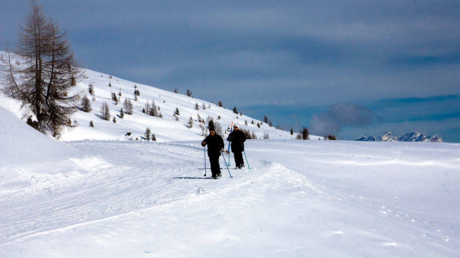 A couple during a snowshoe hike at Passo San Pellegrino