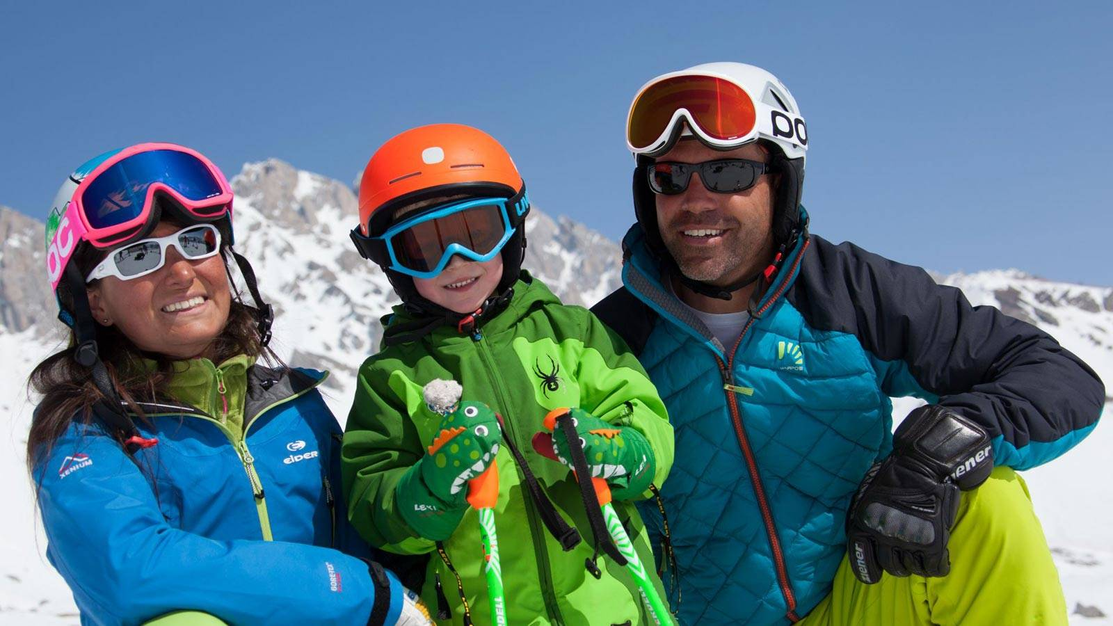A family enjoys a holiday on the snow at Passo San Pellegrino