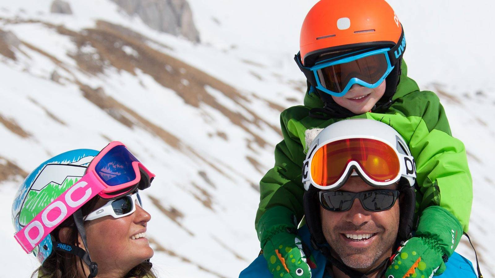 A family enjoys a holiday immersed in the snow at Passo San Pellegrino