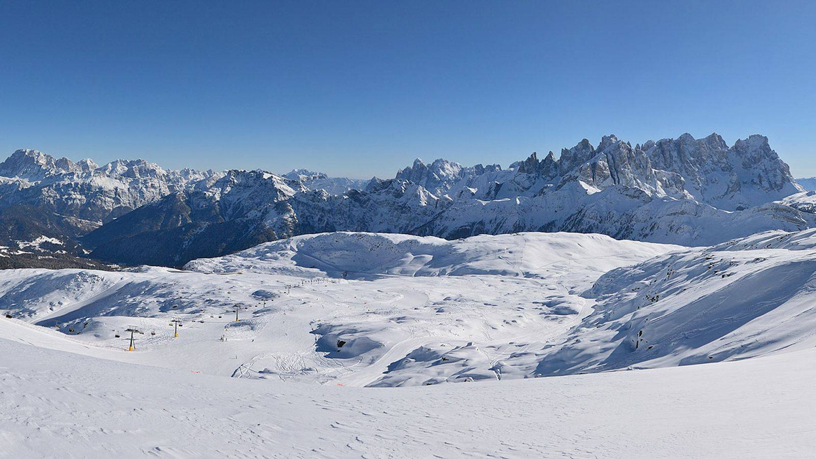 View of the San Pellegrino Pass ski resort surrounded by the Dolomites