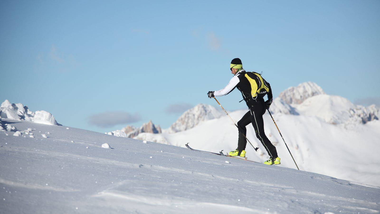 A boy faces a climb on the ski touring slopes