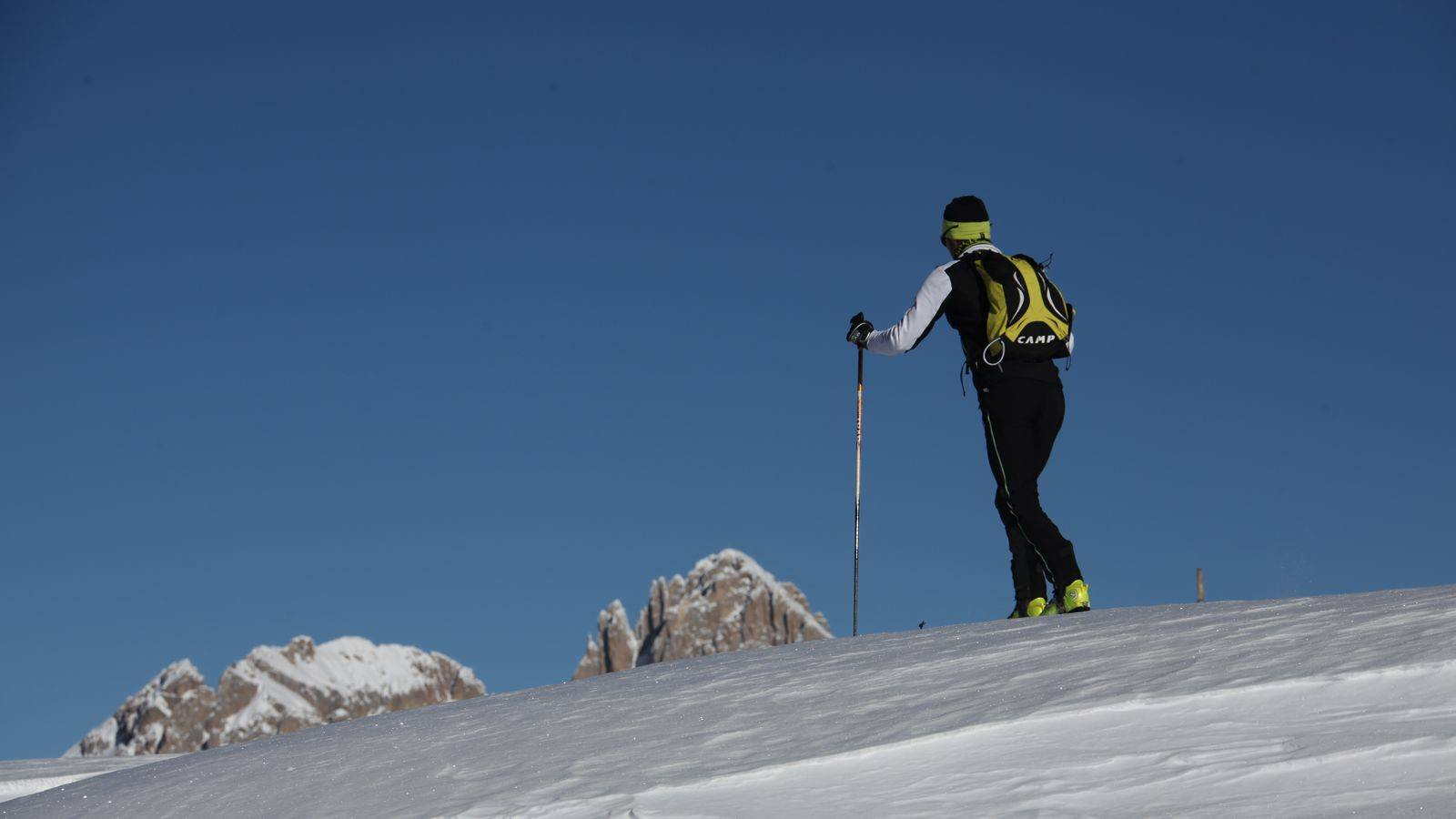 A skier practising ski touring on the ski slopes at Passo San Pellegrino