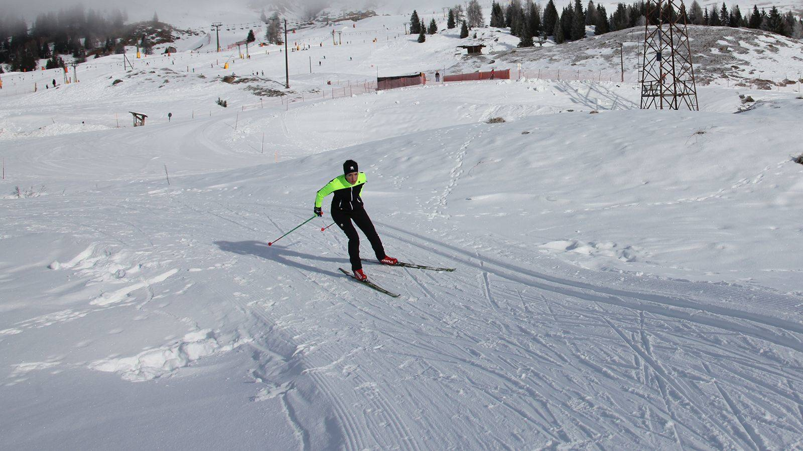 A girl faces the SuperNordicSkipass circuit at Passo San Pellegrino