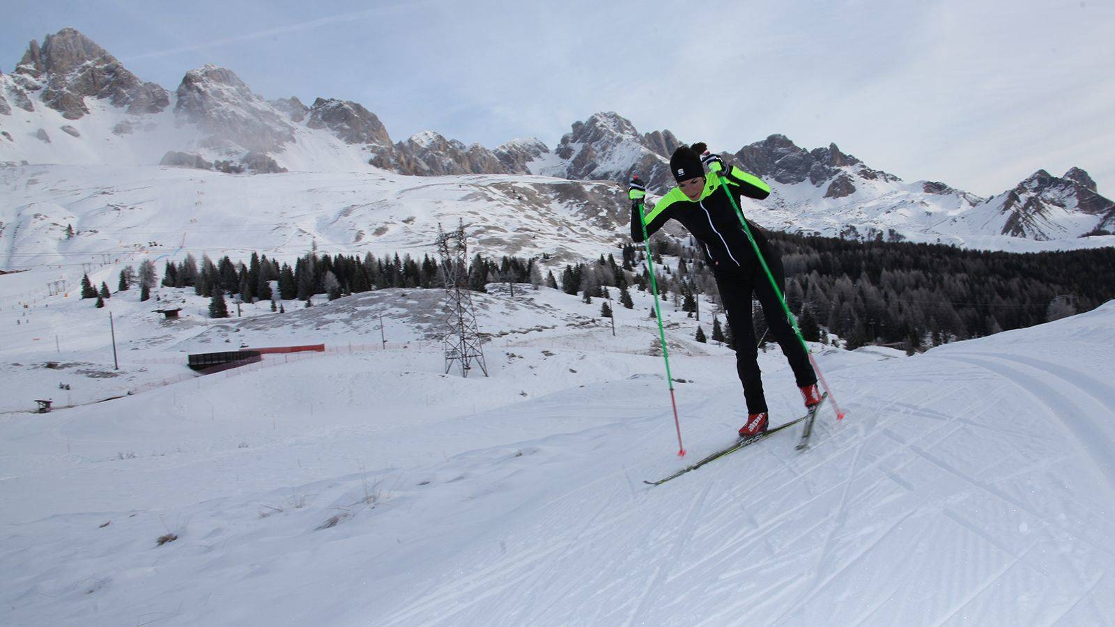 A skier practicing Nordic skiing in the circuit at Passo San Pellegrino