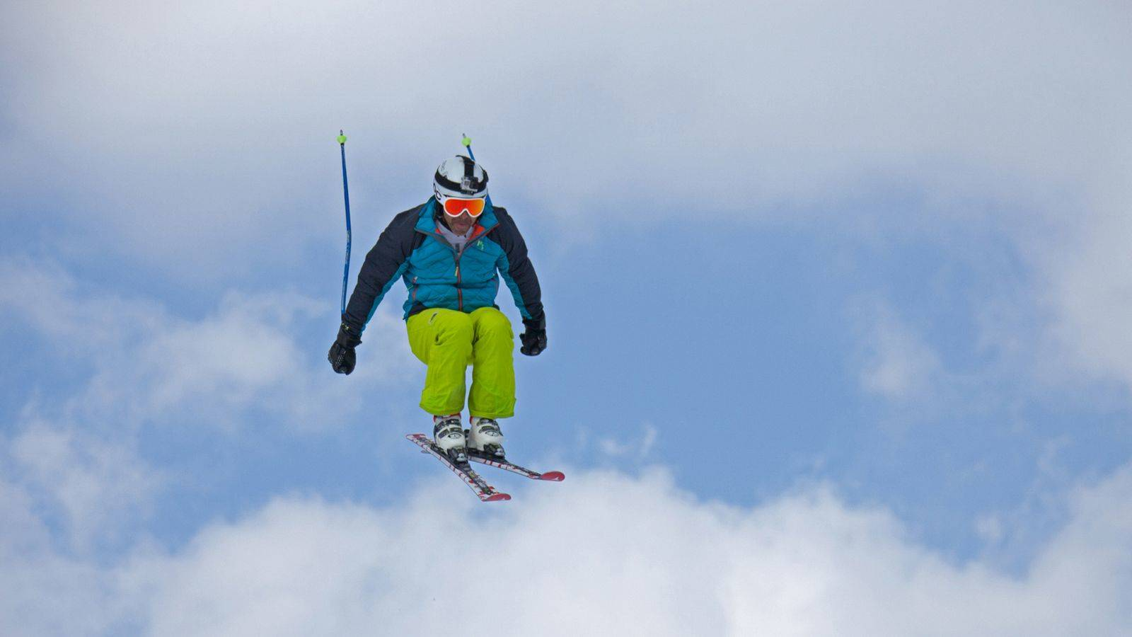 A skier during a jump on the ski slopes