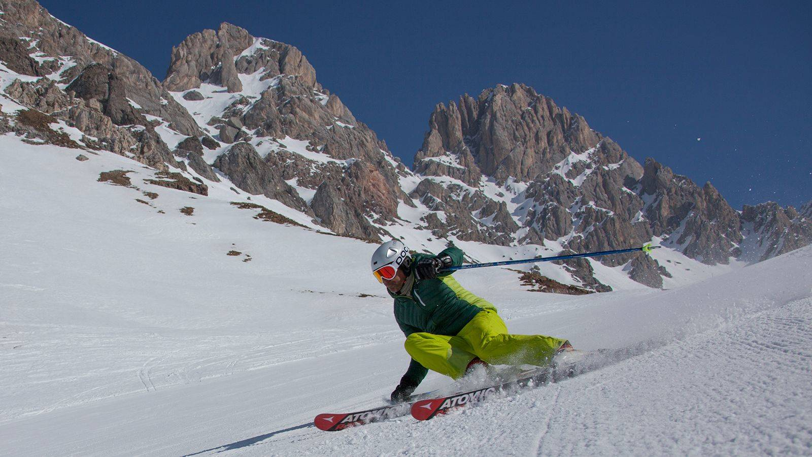 A skier takes a curve on the slopes of San Pellegrino