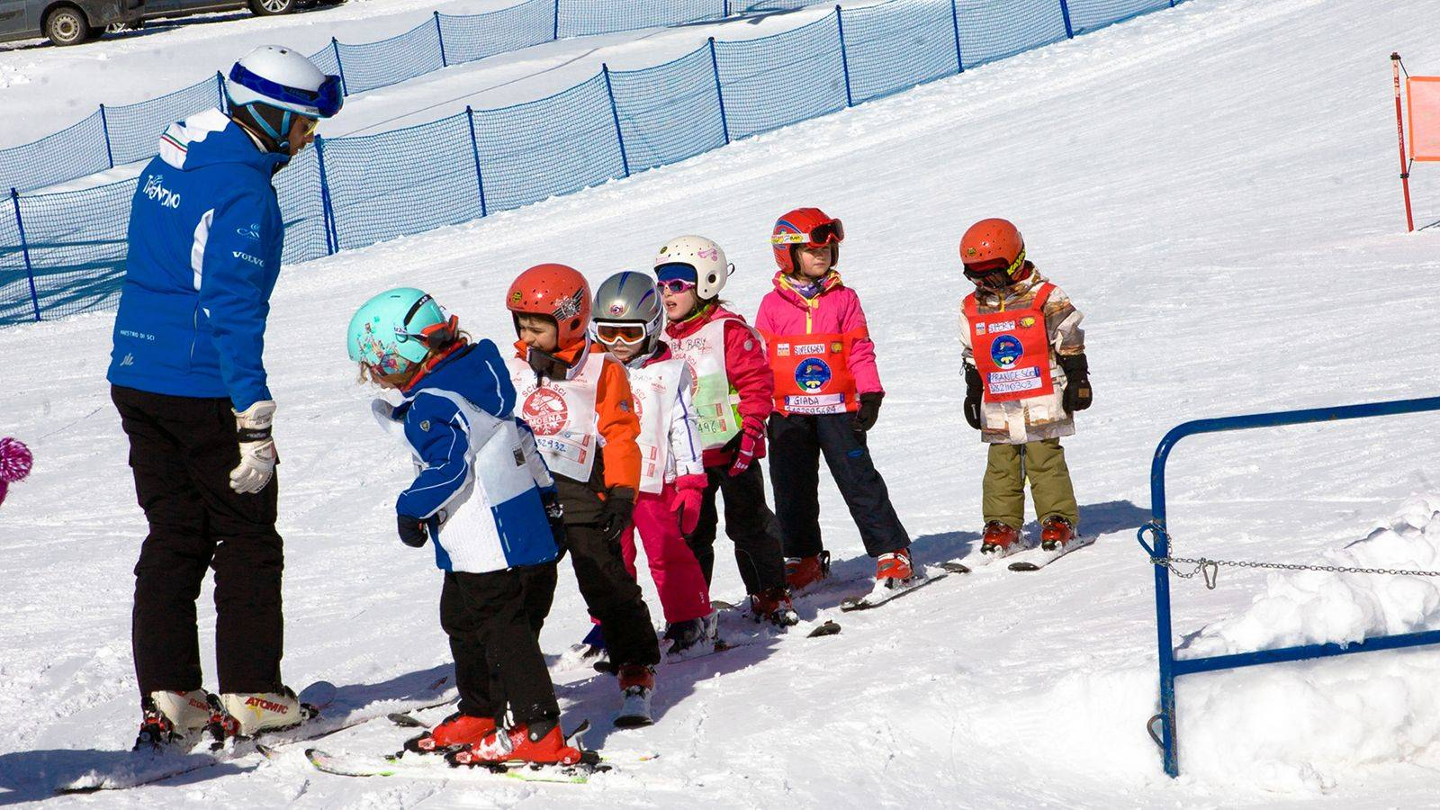 A group of children during the ski lessons at Passo San Pellegrino