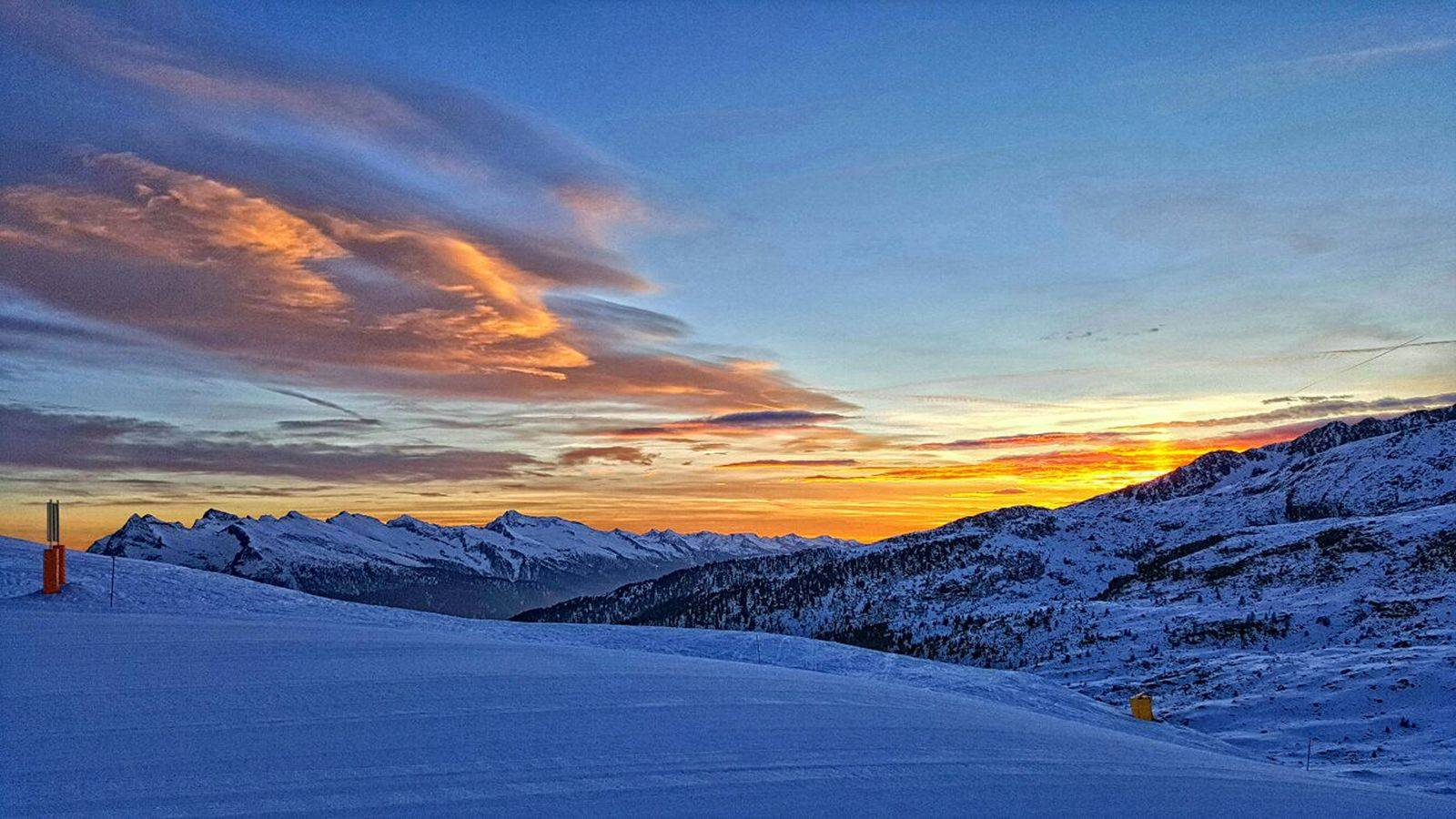 The sun sets on the snowy slopes of Passo San Pellegrino